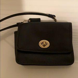 Black Turnlock Coach crossbody bag